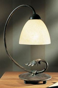 Such a greceful lamp... it is made of iron forged by hand, in Germany
