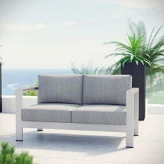 Shore Outdoor Patio Aluminum Loveseat, Silver Gray - Enjoy your patio or backyard leisure time with the strong and durable Shore Outdoor Aluminum Loveseat. Made with an anodized brushed aluminum frame and non-marking black plastic foot caps, Shore comes outfitted with resilient fabric canvas tested to last through all weather conditions. The Shore Outdoor Aluminum Loveseat complements your casual gatherings with a look and functionality you can rely on. Set Includes: One - Shore Loveseat…