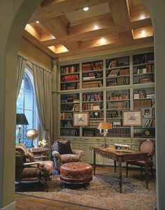 Monardo Tudor Style House - I love the framework on the high ceiling along with the Old World charm of the furniture pieces. It makes a small room feel big and cozy.