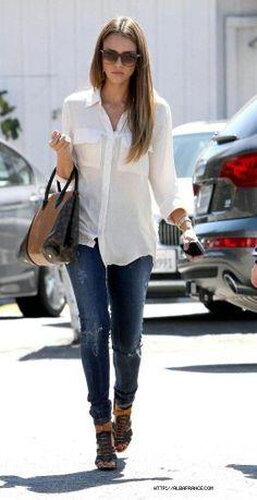 Jessica alba.  Camp shirt, straight leg jeans, and high heeled sandals.