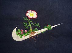 logo van Nike met borduursels