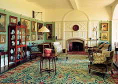 Philip Webb designed the fireplace and paneling in the drawing room at Standen (1892-94 Sussex, England); much of the furniture and the carpet were designed by William Morris.