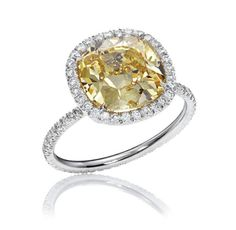 "The One, Yellow Diamond Micropave Ring       ""The One"" with a cushion-cut yellow diamond center stone and pave diamonds, set in platinum"
