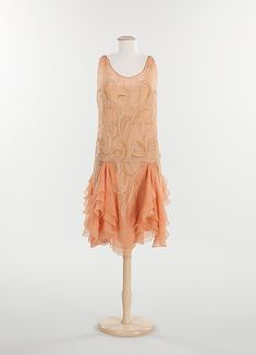Dress, Evening    Date:      1926–28  Culture:      French  Medium:      silk, metal, rhinestones