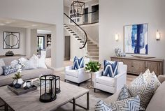 The formal living room features a beautiful color palette and a soothing wall color. The paint color (through-out the house) is Sherwin Williams Agreeable Gray. Pillows are custom using Kravet fabrics.