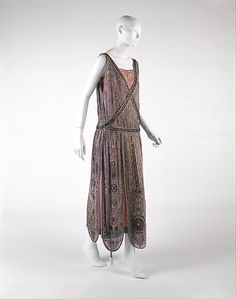 Evening dress  House of Lanvin  (French, founded 1889)  Designer: Jeanne Lanvin (French, 1867–1946) Date: spring/summer 1923 Culture: French Medium: silk, metallic thread, glass beads Dimensions: Length (a): 54 in. (137.2 cm) Length (b): 49 1/2 in. (125.7 cm) Credit Line: Gift of Mrs. Albert Spaulding, 1962