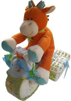 Motorcycle Diaper Cake : Can you say vroom? This motorcycle diaper cake ($89) is not for amateurs, but it sure is impressive! We love how the dishwasher baskets are used as storage compartments for the bike!