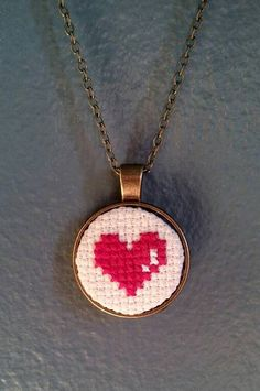 Heart Cross Stitch Necklace, You can create really unique designs for fabrics with cross stitch. Cross stitch versions may almost surprise you. Cross stitch newcomers will make the versions they need without difficulty. Cross Stitch Beginner, Tiny Cross Stitch, Cross Stitch Heart, Simple Cross Stitch, Cross Stitch Alphabet, Cross Stitch Designs, Cross Stitch Patterns, Kawaii Cross Stitch, Cross Heart