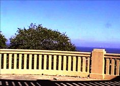 When you reach halfway up the hillside garden in Prestatyn, step on to the viewing platform and you will see magnificent views of the town