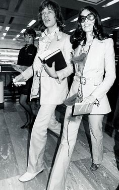 Matching suits for Mick and Bianca Jagger's airport style in 1970—the pair was off to the Bahamas!