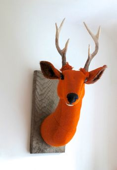 Large orange stag! This piece has fast become a favourite of mine, he has a great presence in the room and the colour is lush! I started this piece by making the antlers. Wire, foil and clay, baked and then painted and varnished twice. I think they came out great and couldnt wait to start working with the bright orange Harris Tweed. I wanted the stag to really come out into the room and worked to get the turn of the neck. His face is hand stitched, each piece of fabric cut free hand and…