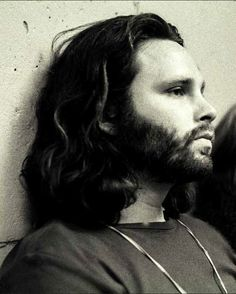 Jim Morrison. I love this picture.. so many emotions are evoked in one still frame.