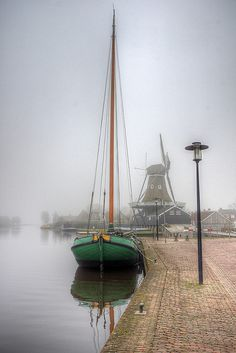 Boat and Windmill on a Misty Day, Friesland, Netherlands ~ Photography by klaash63