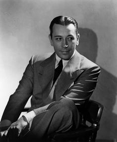 George Raft, usually played a gangster-mobster-type role, but was sleekly handsome. Is said to have been a great dancer, but I haven't run across his hoofer skills yet.