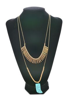 we can't get enough of this tribal looking necklace with the gold & turquoise plus the stone tooth!