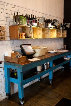 Cafe.  Use my harvest table in front of large shelving unit..barn doors... and crates  open up the kitchen and farm and laundry area