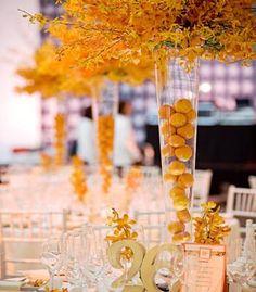 Orange centerpieces - minus the oranges in the vase