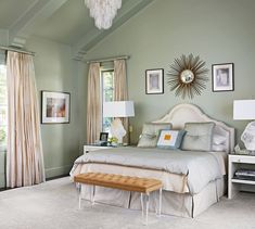 A shimmering blue-green palette keeps this bedroom serenely glam (designed by Jan Showers) - Traditional Home®