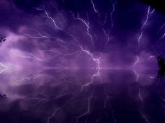 purple lightning reflected in the water