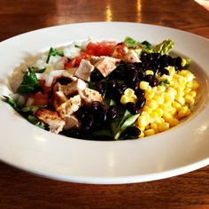 BBQ Chicken Salad w/ Light Ranch BBQ Dressing.  Just 394 calories and $5.99!   http://www.lambsfarm.org/new-healthy-menu-at-magnolia-cafe/