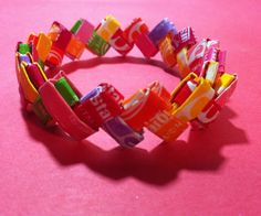 My example: Starburst wrappers (but I've also been successful with Tootsie Roll wrappers) - Keep in mind that the wrapper should be a rectangular shape. - You'll need about 30-40 wrappers depending on how large you want to make your bracelet, and what kind of candy wrapper it is.