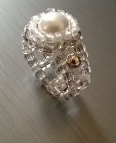 Pearl flower bead ring with silver detail.