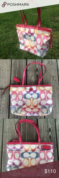 """COACH Pink Scribble Purse Bag 100% authentic Coach purse! Pink patent leather with the """"scribble"""" multicolor pattern. Measures 13"""" across and 9"""" tall. Inside is very clean and comes from a smoke free home. Because of storage, there is a bit of white exposed where the handle leather was folded (see last photo). The bottom is a dirty from sitting on various places. But it is in great condition otherwise!!! Bag / satchel Coach Bags Satchels"""