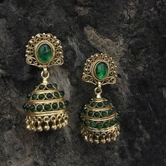Product Details: Base Material - 92.5 Carat Pure Silver with Gold Plating Technique - Handcrafted Product Type - Temple Jewellery  Design -  Jhumka Stones Colour - Green Length - 7 cm  Width - 3 cm  Care Instructions - Avoid Contact with Perfumes and Water Contact No - +91 8095752326 E-Mail - contactus@madhurya.com   Also available in Pure Gold*  Shipping Worldwide