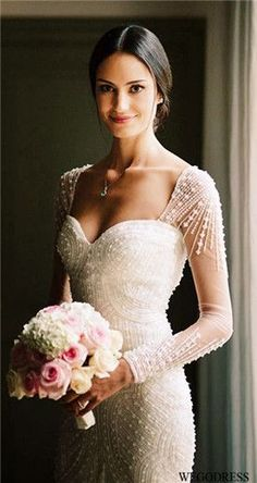 Long sleeved, deco wedding dress.