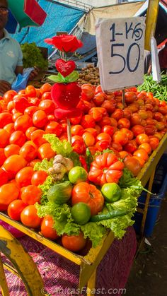 A tomato vendor sets up a Valentine's Day display in Pettah's Manning Market.