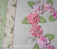 Notice the decorative stitching--stitch-French knot-stitch-French knot.  Also the green stitching on the pink flower yo-yo's to hold them on.
