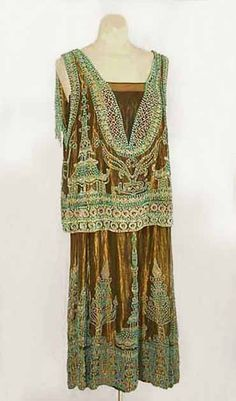 Worth gold lamé evening dress with turquoise Orientalist beading, circa 1923, via the Vintage Textile archives.