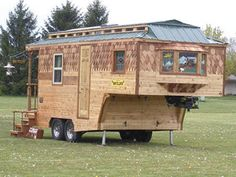 This adorable travel trailer's wood siding is handmade and will only get better with age. For more information, visit Wayzalot.