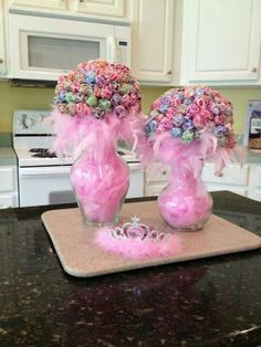 Pink boa feathers filled in a glass vase with suckers. Great centerpiece ideas. Great for fall time. Just fill with leaves or something else.