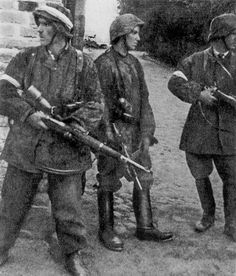 Polish guerrillas from Batalion Zośka dressed in stolen German uniforms and armed with stolen weapons, fighting in the Warsaw Uprising, the largest anti-Nazi guerrilla warfare in Europe. 1944 via reddit