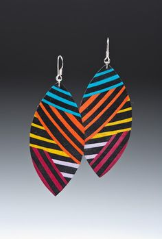 Two and a half inch by one and a half inch leaf shaped earrings with hand colored geometric print on silver plated surgical steel hooks. Fabric Earrings, Paper Earrings, Wooden Earrings, Fabric Jewelry, Polymer Clay Earrings, Diy Earrings, African Earrings, African Jewelry, Diy Jewelry Necklace
