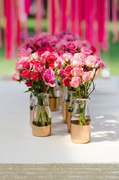 Painted gold milk jars turned adorable vases.