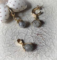 Conjunto de brinco e pingente banhado em ouro com turmalinas facetadas