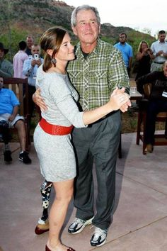 "President George Bush dances with a wounded warrior at his ranch.  How many know that he hosts several Wounded Warrior weekends at his ranch every year?  Dancing with a ""Wounded Warrior"" This man has character."