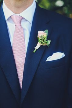 Pink polka dot tie and mini rose bout | Photography: Christina Carroll Photography - christinacarrollphotography.com  Read More: http://www.stylemepretty.com/southwest-weddings/2014/05/01/rustic-wild-onion-ranch-wedding/