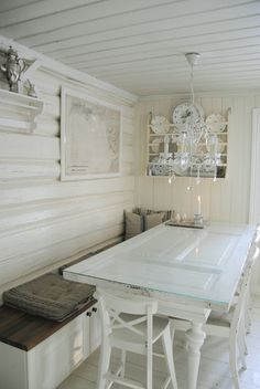 Fantastic idea using a old door with glass on top of it as a table.