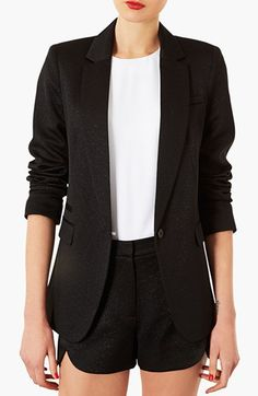 The black blazer with the white tee inside & black shorts brings out a fun, classy and casual business look.