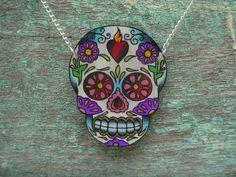 sugar skull with sacred heart tattoo necklace (dia de los muertos calavera). $25.00, via Etsy.