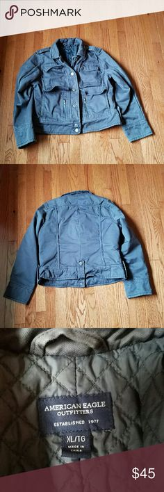 American Eagle Mens Cargo Jacket XL In good used condition. There are signs of wear and fading to fabric throughout. Plus one spot that did not come out in the wash that is under the right arm. Lots of life left! Will keep you warm. Jacket is a dark gray/blueish color. American Eagle Outfitters Jackets & Coats