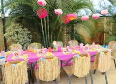 Hawaiian party table | Catchmyparty.com Look how they strung the flowers.