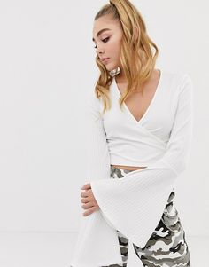 1e9f7edd962837 PrettyLittleThing flare sleeve ribbed wrap tie crop top in white