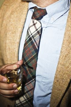 The light weight oxford shirt nicely breaks up the thick textures of the plaid tie and light tweed coat.