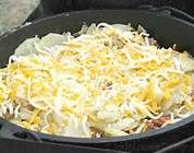 dutch oven potatoes, cheese and bacon