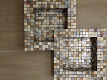 Creative White Matter shelves for tiled shower applications.