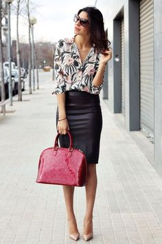 Black pencil skirt, print blouse and pop of red.